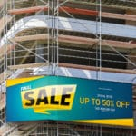 Blank space on a scaffolding building for your advertising. whit